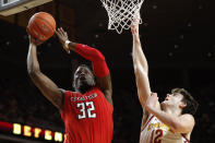 Texas Tech center Norense Odiase (32) drives to the basket over Iowa State forward Michael Jacobson during the first half of an NCAA college basketball game, Saturday, March 9, 2019, in Ames, Iowa. (AP Photo/Charlie Neibergall)