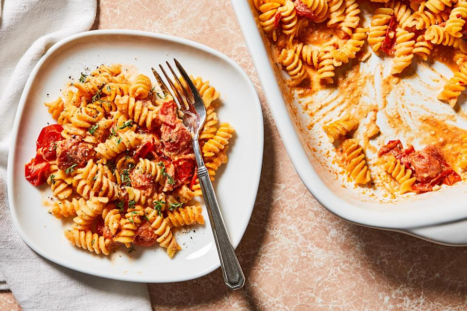 """<p>Tomatoes and briny feta cheese form the base of the sauce that coats the pasta in this easy one-pan meal. Enjoy on its own as a vegetarian dinner or top with grilled chicken for some extra protein. <a href=""""https://www.eatingwell.com/recipe/7897565/baked-tomato-feta-pasta/"""" rel=""""nofollow noopener"""" target=""""_blank"""" data-ylk=""""slk:View Recipe"""" class=""""link rapid-noclick-resp"""">View Recipe</a></p>"""