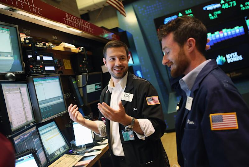 Investors on the floor of the New York Stock Exchange