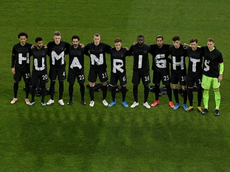 "Germany's players with the wording ""Human rights"" on their T-shirts before Thursday's 3-0 win over Iceland in a 2022 World Cup qualifier in Duisburg"