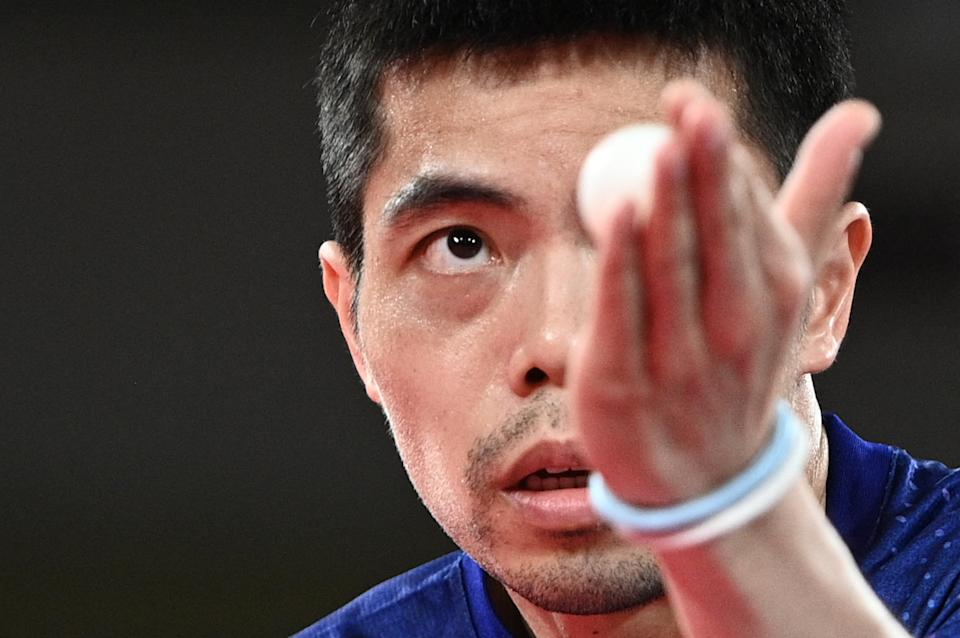 Taiwan's Chuang Chih-yuan competes against Argentina's Horacio Cifuentes during his men's singles round 2 table tennis match at the Tokyo Metropolitan Gymnasium during the Tokyo 2020 Olympic Games in Tokyo on July 25, 2021. (Photo by Anne-Christine POUJOULAT / AFP) (Photo by ANNE-CHRISTINE POUJOULAT/AFP via Getty Images)