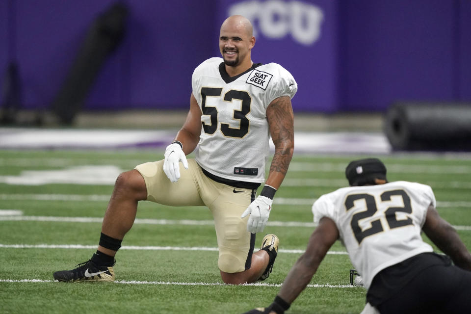 New Orleans Saints linebacker Zack Baun (53) smiles as he stretches with teammates during NFL football practice in Fort Worth, Texas, Wednesday, Sept. 15, 2021. (AP Photo/LM Otero)