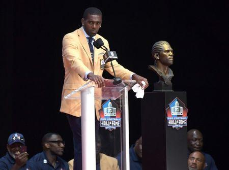 Aug 4, 2018; Canton, OH, USA;Minnesota Vikings, Oakland Raiders, New England Patriots, Tennessee Titans and San Francisco 49ers former receiver Randy Moss speaks during the Pro Football Hall of Fame Enshrinement Ceremony at Tom Bensen Stadium. Mandatory Credit: Kirby Lee-USA TODAY Sports