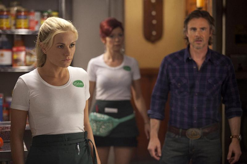 """This image released by HBO shows, from left, Anna Paquin as Sookie Stackhouse, Carrie Preston as Arlene Fowler, Sam Trammell as Sam Merlotte in a scene from """"True Blood."""" Recipes by Marcelle Bienvenu, inspired by the popular supernatural series, have been gathered in a book """"True Blood: East, Drinks, and Bites from Bon Temps."""" (AP Photo/HBO)"""