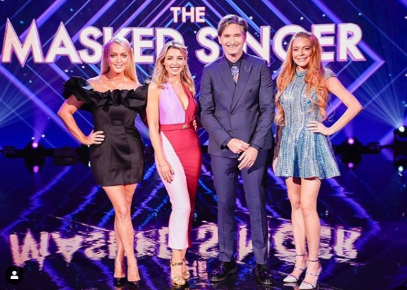 A photo of The Masked Singer Australia judges: Aussie singer and TV personality Dannii Minogue, American actor and Parent Trap star Lindsay Lohan, radio host and funnyman Dave 'Hughesy' Hughes and Kyle And Jackie O Show host Jackie O Henderson.
