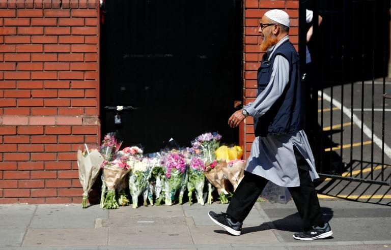 Floral tributes are left outside the Finsbury Park mosque in north London, on June 19, 2017