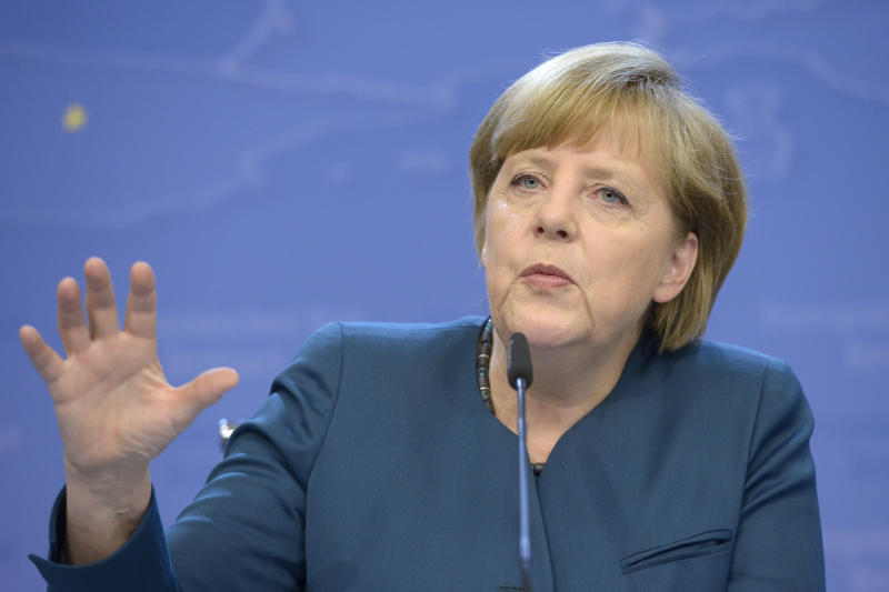 German Chancellor Angela Merkel addresses the media at the end of an EU summit in Brussels on Wednesday, May 22, 2013. European Union leaders on Wednesday sought to advance their fight against tax fraud and close the loopholes for large corporations' tax avoidance schemes. (AP Photo/Ezequiel Scagnetti)