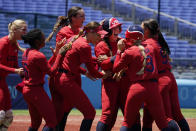 United States' Amanda Chidester, center, is mobbed by teammates after a game winning hit in the eighth inning of a softball game against Australia at the 2020 Summer Olympics, Sunday, July 25, 2021, in Yokohama, Japan. (AP Photo/Sue Ogrocki)