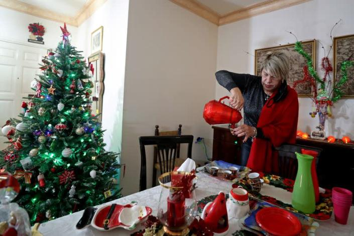 Palestinian Christian woman Ghada Abu Daoud pours a cup of coffee as she decorates her house ahead of Christmas in Gaza City