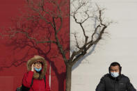Residents wearing masks to protect from the coronavirus cross a junction in Beijing on Wednesday, Jan. 20, 2021. (AP Photo/Ng Han Guan)