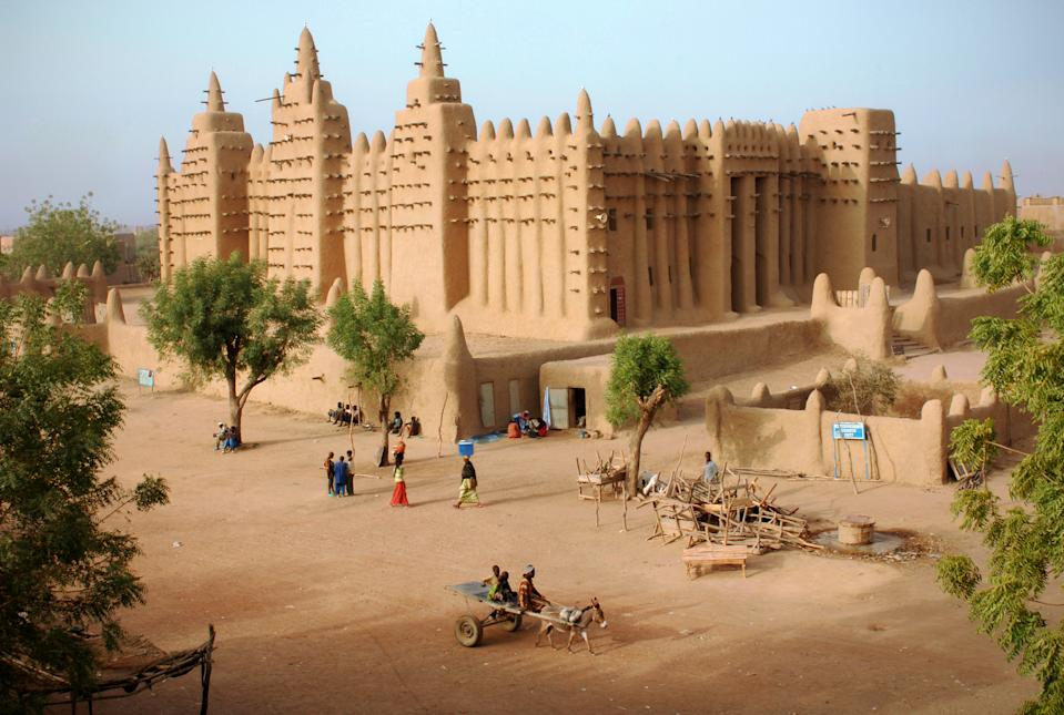 The great Mosque in the Sahara desert city of Djenné in Mali, West Africa near Timbuktu - the largest mud (adobe) building in the world The Great Mosque of Djenné is a large banco or adobe building that is considered by many architects to be one of the greatest achievements of the Sudano-Sahelian architectural style. The mosque is located in the city of Djenné, Mali, on the flood plain of the Bani River. The first mosque on the site was built around the 13th century, but the current structure dates from 1907. Heritage sites around the world are under threat due to conditions created by climate change. Increased risk for floods or fire put some of the world's most famous monuments and locations in jeopardy. (Getty)