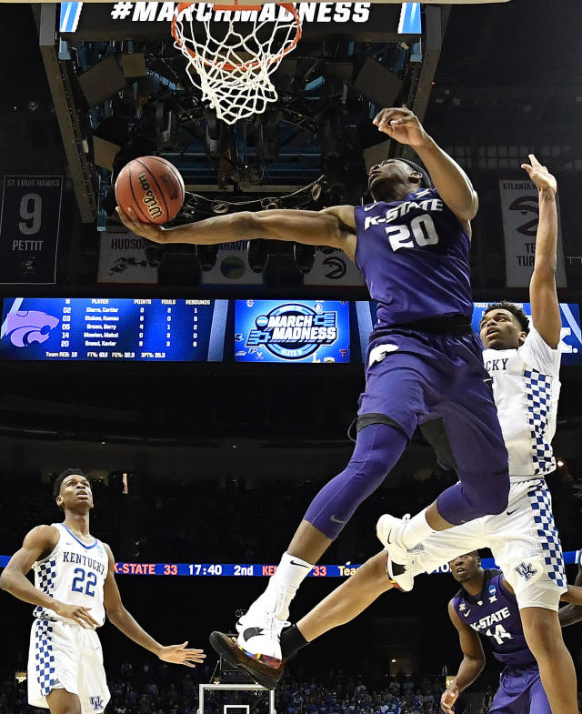 Kansas State forward Xavier Sneed (20) shoots against Kentucky forward PJ Washington, right, during the second half of a regional semifinal NCAA college basketball tournament game, Friday, March 23, 2018, in Atlanta. Kansas State won 61-58. (AP Photo/John Amis)