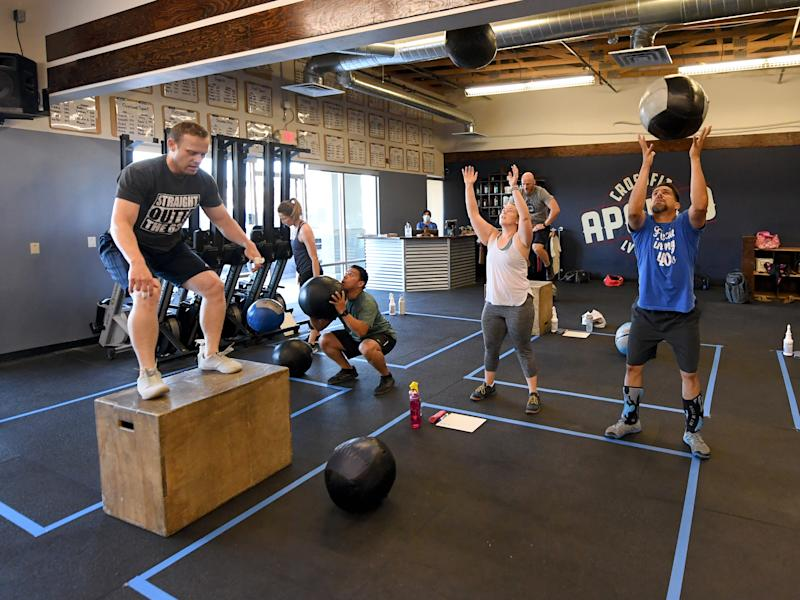 LAS VEGAS, NEVADA - MAY 29: People work out at CrossFit Apollo, which opened for the first time since closing on March 17 due to the statewide shutdown because of the coronavirus (COVID-19) pandemic on May 29, 2020 in Las Vegas, Nevada. As part of a phased reopening of the state's economy, gyms and fitness facilities were allowed to reopen today with social distancing guidelines and other restrictions in place. (Photo by Ethan Miller/Getty Images)