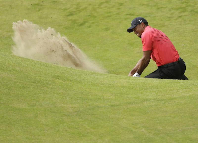 Tiger Woods of the United States hits the ball out of the bunker on the sixth hole on his second attempt at Royal Lytham & St Annes golf club during the final round of the British Open Golf Championship, Lytham St Annes, England Sunday, July 22, 2012. (AP Photo/Peter Morrison)
