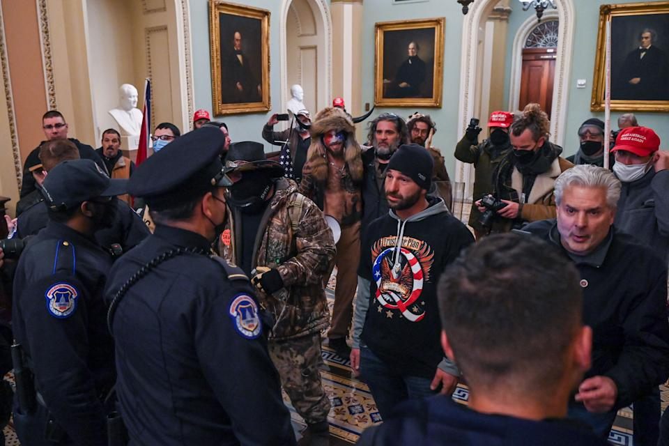 US Capitol police officers try to stop supporters of US President Donald Trump to enter the Capitol on January 6, 2021, in Washington, DC. - Demonstrators breeched security and entered the Capitol as Congress debated the a 2020 presidential election Electoral Vote Certification. (Photo by Saul LOEB / AFP) (Photo by SAUL LOEB/AFP via Getty Images)