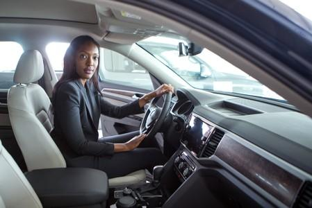 Michaella Rugwizangoga, Chief Executive Officer of Volkswagen Mobility Solutions in Rwanda, sits inside a car in Kigali
