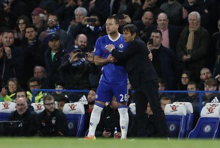Britain Football Soccer - Chelsea v Southampton - Premier League - Stamford Bridge - 25/4/17 Chelsea's John Terry speaks to manager Antonio Conte before coming on as a substitute Reuters / Stefan Wermuth Livepic