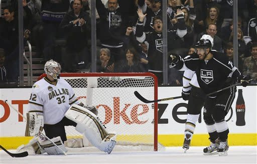 Los Angeles Kings' Dwight King, right, celebrates a goal by Trevor Lewis as he skates near Dallas Stars goalie Kari Lehtonen, of Finland, during the first period of an NHL hockey game in Los Angeles, Thursday, March 7, 2013. (AP Photo/Jae C. Hong)
