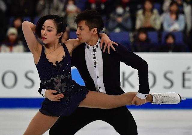 China's Sui Wenjing and Han Cong compete in the pairs short program at the ISU World Figure Skating Championships in Helsinki, Finland on March 29, 2017 (AFP Photo/John MACDOUGALL)