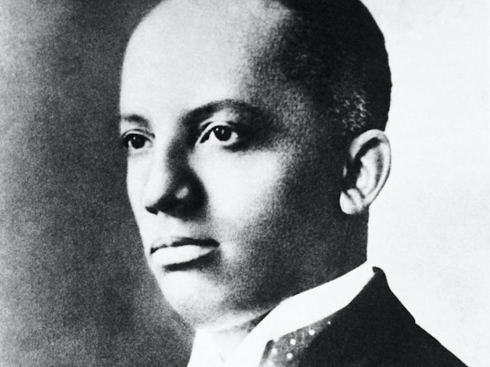 Carter Goodwin Woodson (1875-1950), African-American historian is shown in a head and shoulders portrait.