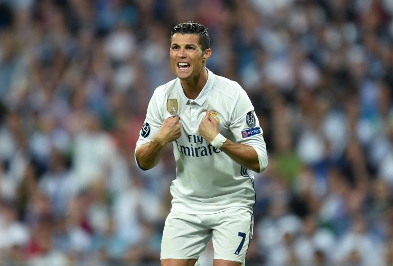 Real Madrid's Portuguese striker Cristiano Ronaldo gestures during the UEFA Champions League quarter-final match against Bayern Munich at the Santiago Bernabeu stadium in Madrid on April 18, 2017