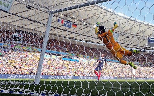 France's goalkeeper Hugo Lloris fails to stop a shot by Germany's Mats Hummels as he scored his side's first goal during the World Cup quarterfinal soccer match between Germany and France at the Maracana Stadium in Rio de Janeiro, Brazil, Friday, July 4, 2014