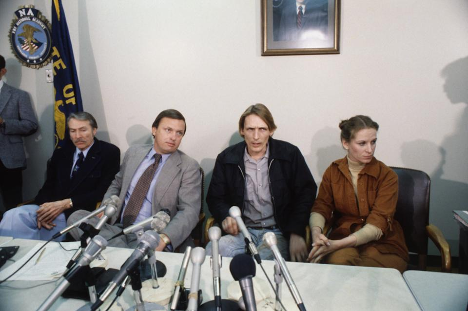 FBI agent Ralph Himmelsbach (L) agent Wm. Baker seated with Mr. & Mrs. Harold D. Ingram during press conference on recovery of the D.B. Cooper hijacking (1971) money they found while on a family outing on the shore of the Columbia River.
