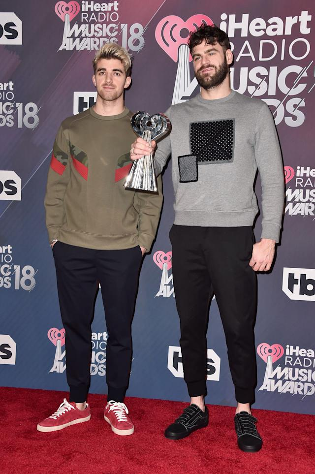 INGLEWOOD, CA - MARCH 11: Andrew Taggart (L) and Alex Pall of The Chainsmokers, winners of the awards for Best Collaboration for 'Something Just Like This;' Dance Artist of the Year; and Dance Album of the Year for 'Memories...Do Not Open' pose in the press room during the 2018 iHeartRadio Music Awards which broadcasted live on TBS, TNT, and truTV at The Forum on March 11, 2018 in Inglewood, California. (Photo by Alberto E. Rodriguez/Getty Images)