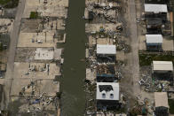 In this aerial photo, the remains of damaged homes are seen in the aftermath of Hurricane Ida, Monday, Sept. 6, 2021, in Grand Isle, La. (AP Photo/Matt Slocum)