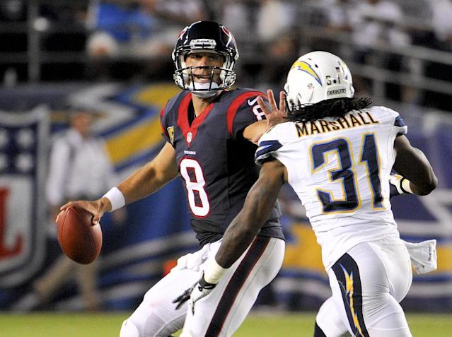 Houston Texans quarterback Matt Schaub throws under pressure by San Diego Chargers defensive back Richard Marshall during the second half of an NFL football game Monday, Sept. 9, 2013, in San Diego. (AP Photo/Denis Poroy)
