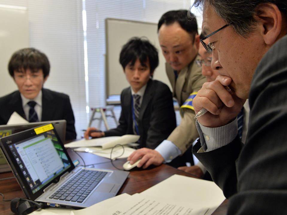 Japanese government officers held a cyber security drill in 2014 as country prepared to host the 2020 Olympics (Yoshikazu Tsuno/AFP via Getty Images)