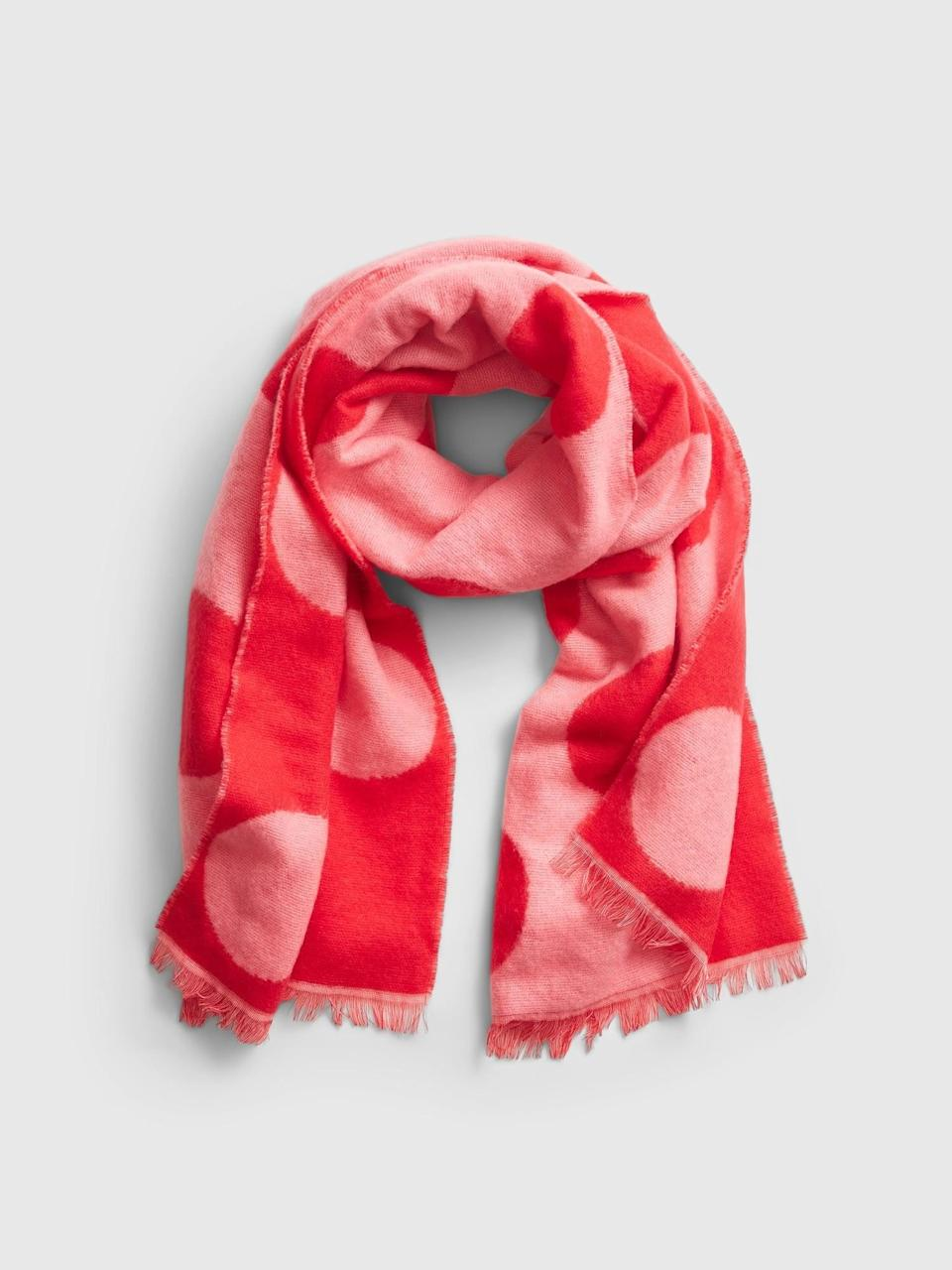 <p>This pink and red <span>Gap Brushed Scarf</span> ($17, originally $35) is a cute easy way to get into the spirit. And cozy too!</p>