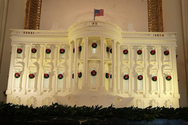 <p>The White House gingerbread house is on display in the State Dining Room at the White House during a press preview of the 2017 holiday decorations Nov. 27, 2017 in Washington, D.C. (Photo: Saul Loeb/AFP/Getty Images) </p>