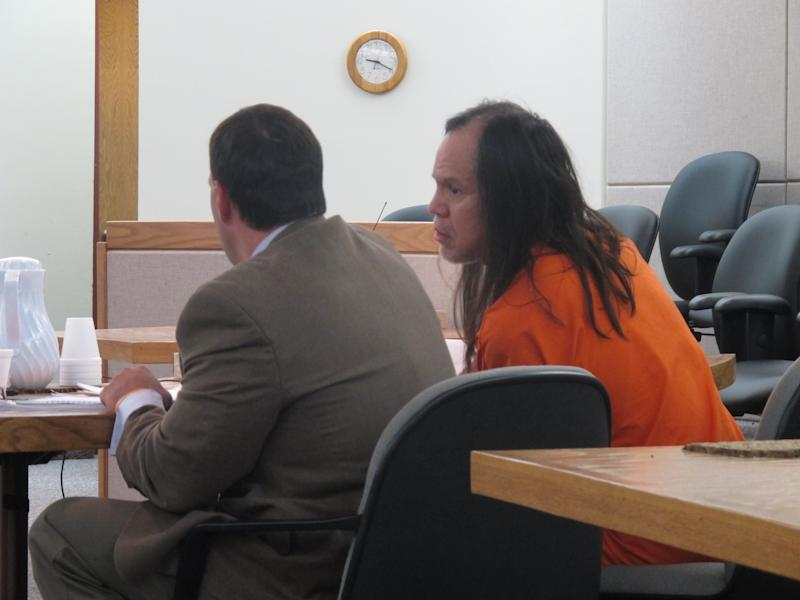 John Marvin Jr. leans in toward his attorney, Eric Hedland, prior to Marvin's sentencing on Friday, April 5, 2013, in Juneau, Alaska. Marvin was sentenced to two consecutive sentences of 99 years in the deaths of two police officers. (AP Photo/Becky Bohrer)