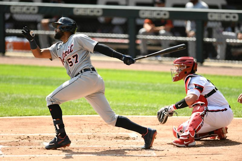 Tigers left fielder Jorge Bonifacio, left, watches his RBI-single during the first inning of a baseball game against the Chicago White Sox, Sunday, Sept. 13, 2020, in Chicago.