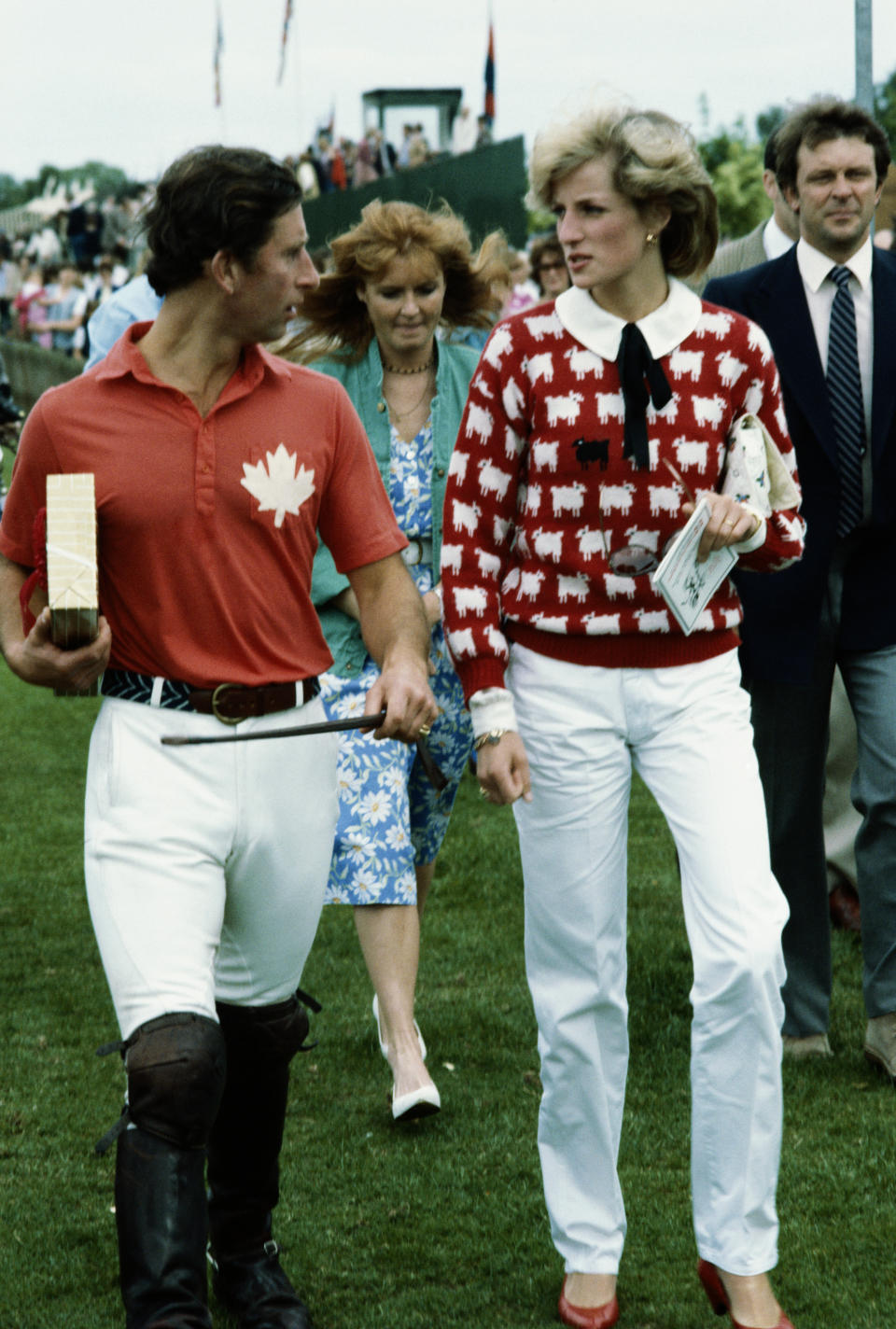 Princess Diana (1961 - 1997) in a Smith's Lawn sweater, with Prince Charles at a polo meeting at Windsor, June 1983. With them is Sarah Ferguson (centre). (Photo by Jayne Fincher/Princess Diana Archive/Getty Images)