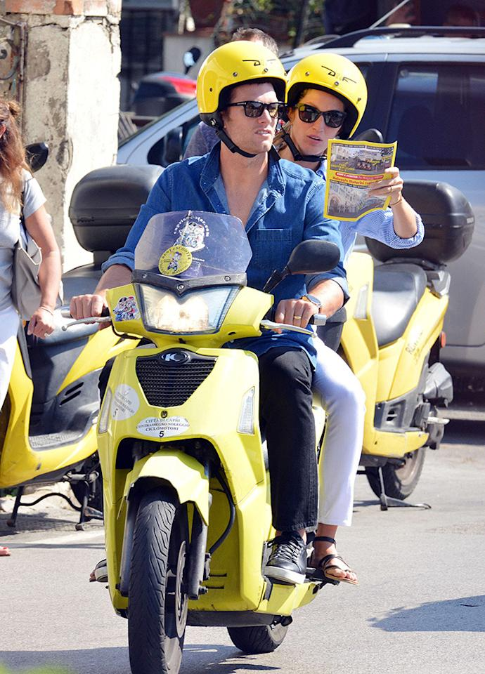 <p>The two looked straight out of a scene in Roman Holiday, as they sped around town on a yellow Vespa. (Photo: AKM-GSI)</p>