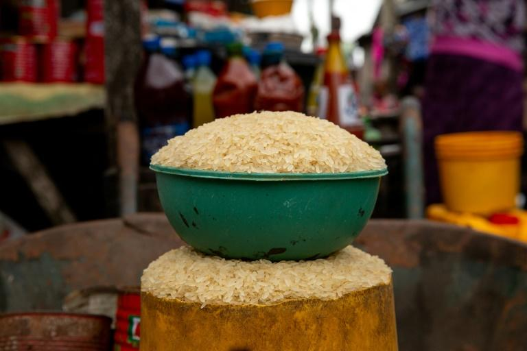 The price of rice has skyrocketed in Nigeria after border closures to encourage domestic agriculture and industry (AFP Photo/Benson IBEABUCHI)
