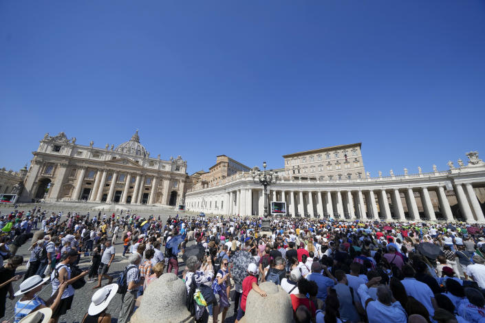 People crowd St. Peter's Square, at the Vatican, as Pope Francis recites the Angelus noon prayer from the window of his studio, Sunday, Sept. 5, 2021. (AP Photo/Andrew Medichini)