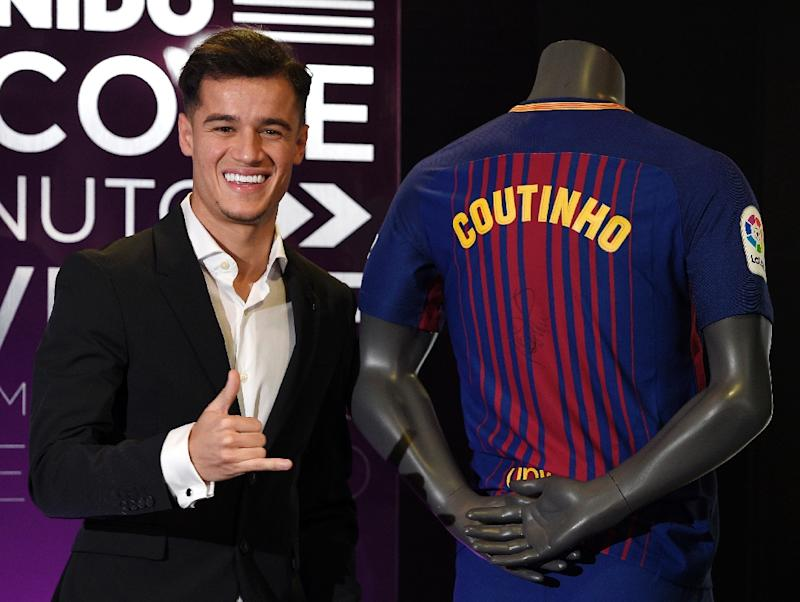Barcelona's new Brazilian midfielder Philippe Coutinho poses with his new jersey during his official presentation in Barcelona on January 8, 2018