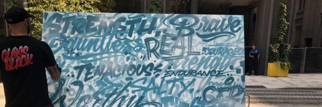 Philadelphia graffiti artist MECRO finishes a mural of words from people who live with dysautonomia.