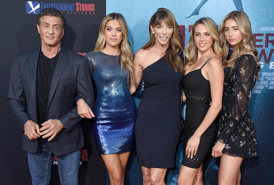 WESTWOOD, CA - AUGUST 13: Sylvester Stallone, Sistine Rose Stallone, Jennifer Flavin, Sophia Rose Stallone, and Scarlet Rose Stallone arrive at the LA Premiere Of Entertainment Studios'