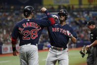 Boston Red Sox's J.D. Martinez (28) celebrates with Xander Bogaerts after hitting a two-run home run against the Tampa Bay Rays during the inning of a baseball game Saturday, July 31, 2021, in St. Petersburg, Fla. (AP Photo/Scott Audette)
