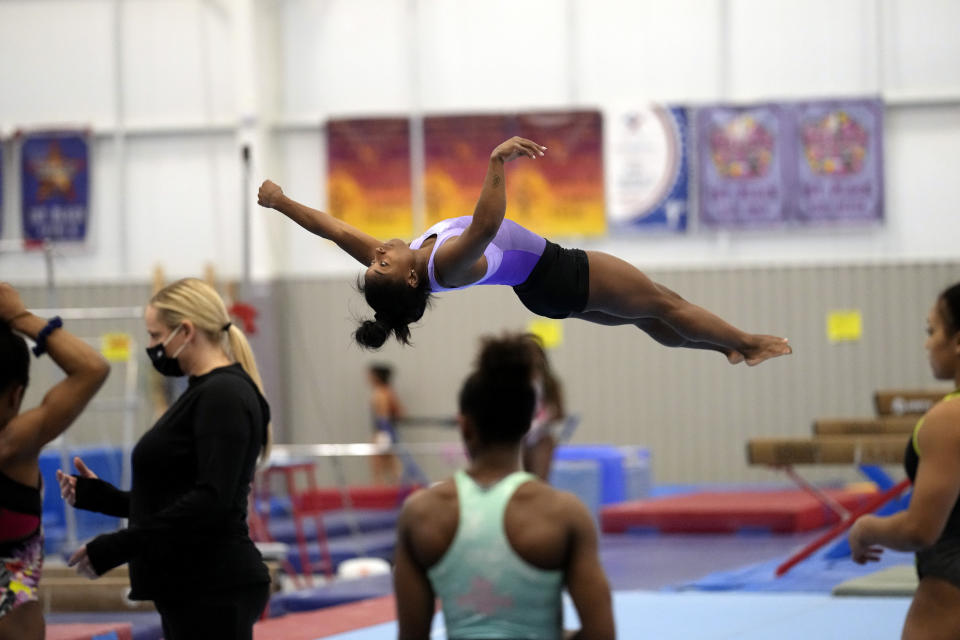 Reigning Olympic champion gymnast Simone Biles practices her floor routine during a training session Tuesday, May 11, 2021, in Spring, Texas. (AP Photo/David J. Phillip)