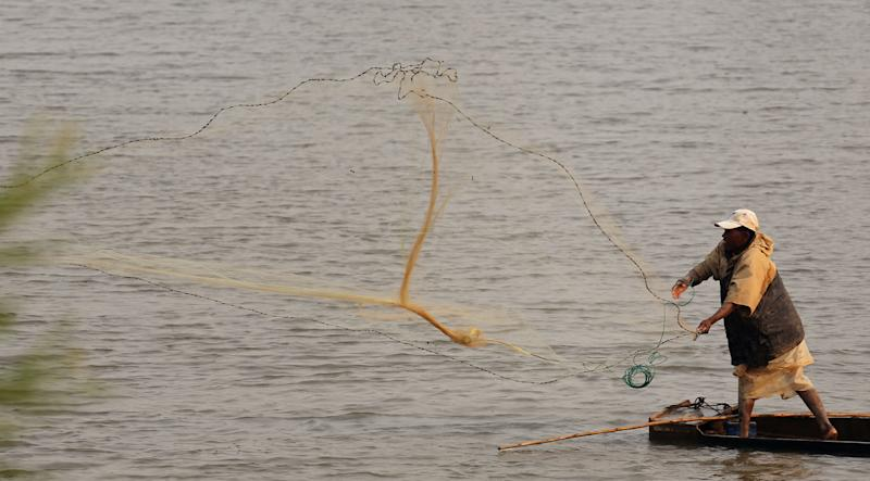 A man cast his fishing net in a river near the city of Antananarivo, Madagascar, Thursday, Oct. 24, 2013. Madagascar will hold elections on Friday that organizers hope will end political tensions that erupted in a 2009 coup and help lift the aid-dependent country out of poverty. The island nation in the Indian Ocean plunged into turmoil after Andry Rajoelina, the current president, forcibly took power from former President Marc Ravalomanana with the backing of the military. (AP Photo/Schalk van Zuydam)
