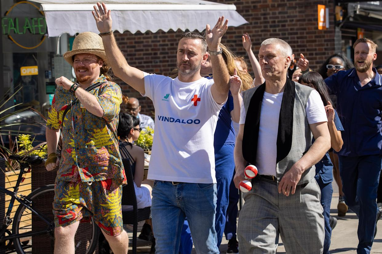 Will Mellor, Keith Lemon, and Bez from the Happy Mondays, were spotted today filming scenes, in Hoxton, for a new charity music video called�Vindaloo Part Two, which has been supported and backed by�Deliveroo�to raise funds for the NHS, as proceeds from the sale of the song will go to NHS charities.�It�s rumored more celebrity faces will appear in the video to support the charity single. The release date is yet to be revealed but it�s believed to be in time for the first UEFA EURO 2020 England game. (Photo by Phil Lewis / SOPA Images/Sipa USA)