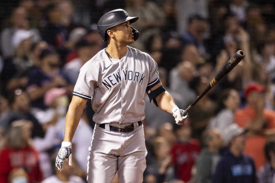 BOSTON, MA - SEPTEMBER 26: Giancarlo Stanton #27 of the New York Yankees reacts after hitting a two run home run during the eighth inning of a game against the Boston Red Sox on September 26, 2021 at Fenway Park in Boston, Massachusetts. (Photo by Billie Weiss/Boston Red Sox/Getty Images)