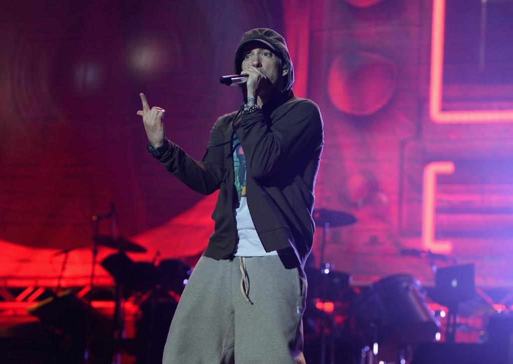 """Eminem, seen here in a 2014 performance at Lollapalooza Day One at Grant Park in Chicago, reveals a politically aware side in his new studio album, """"Revival"""" (AFP Photo/Theo Wargo)"""