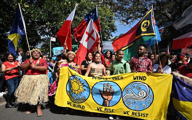 Pacific Islanders attend a protest march as part of the worlds largest climate strike in Sydney on September 20, 2019. | PETER PARKS/Getty Images