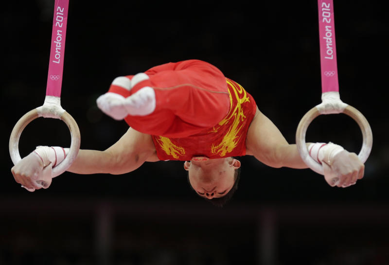 Chinese gymnast Chen Yibing performs on the rings during the artistic gymnastics men's apparatus finals at the 2012 Summer Olympics, Monday, Aug. 6, 2012, in London. (AP Photo/Gregory Bull)